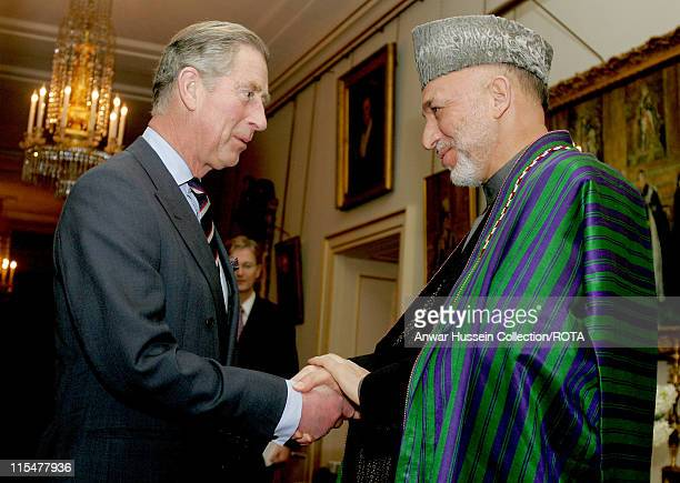Prince Charles, Prince of Wales shakes hands with President Hamid Karzai of Afghanistan at Clarence House in London on Feb. 14, 2007.