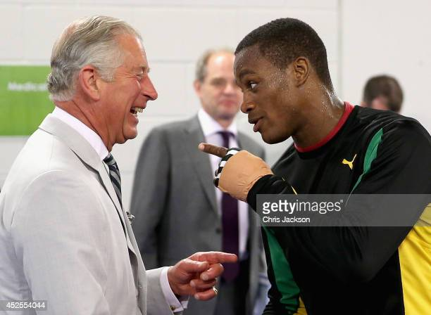Prince Charles, Prince of Wales shares a joke with a member of the Jamaican Commonwealth Boxing Team as he visits the Emirates Arena and Chris Hoy...