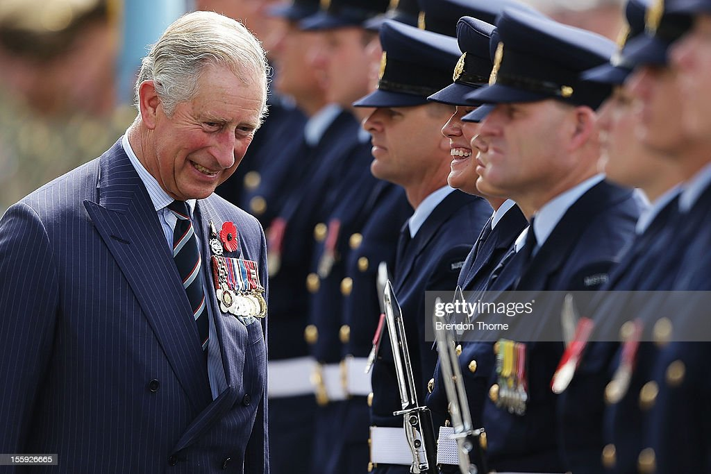 Prince Charles, Prince of Wales shares a joke with an Airman whilst inspecting the Royal Guard at Garden Island on November 9, 2012 in Sydney, Australia. The Royal couple are in Australia on the second leg of a Diamond Jubilee Tour taking in Papua New Guinea, Australia and New Zealand.