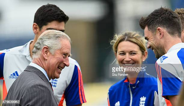 Prince Charles Prince of Wales shares a joke with England cricketers Alastair Cook Charlotte Edwards and James Anderson during a Royal visit ahead of...