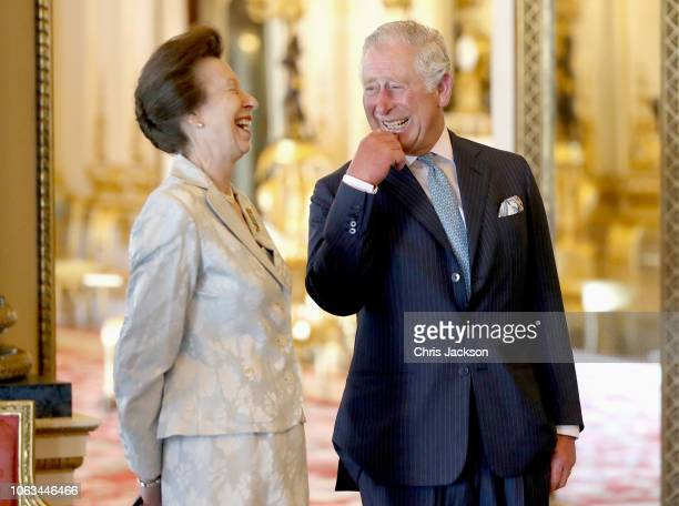Prince Charles, Prince of Wales shares a joke with Princess Anne, Prince Royal as they wait with Members of the Royal Family ahead of the formal...