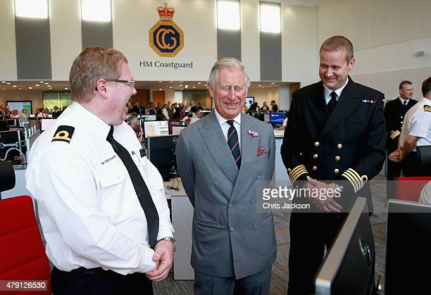 Prince Charles Prince of Wales shares a joke with Steve Carson National Maritime Operations Commander and Richard Cockerill at the National Maritime...