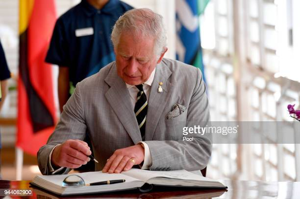 Prince Charles Prince of Wales signs the visitor book a reception at Government House on April 10 2018 in Darwin Australia The Prince of Wales and...
