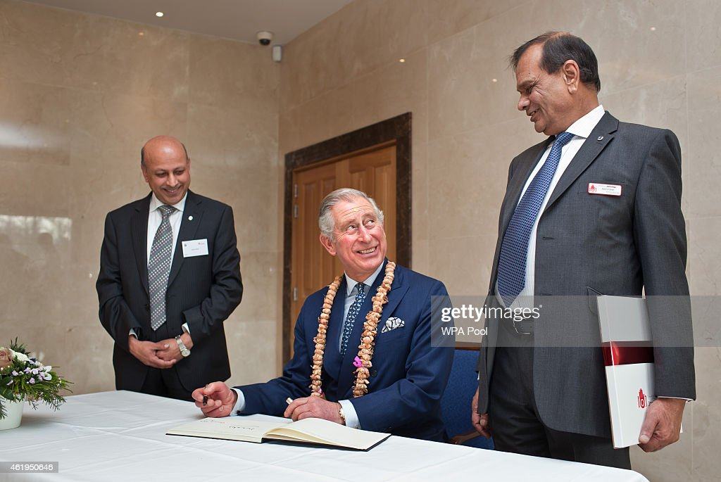 Prince Charles, Prince Of Wales signs the visitors book toward the end of a tour of the Jain Temple on January 22, 2015 in Potters Bar, Hertfordshire, England. The Prince Of Wales was later presented with the Ahimsa Award which recognises individuals who show compassion and tolerance to humanity, animals and the environment.