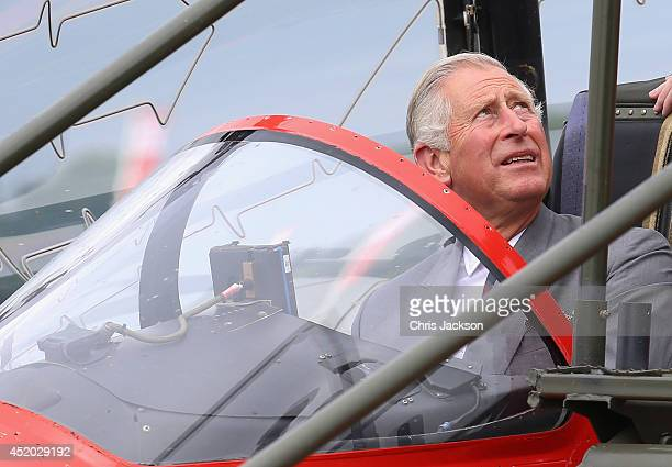 Prince Charles, Prince of Wales sits in the cockpit of a Red Arrows Jet during a visit to the Royal International Air Tattoo at RAF Fairford on July...