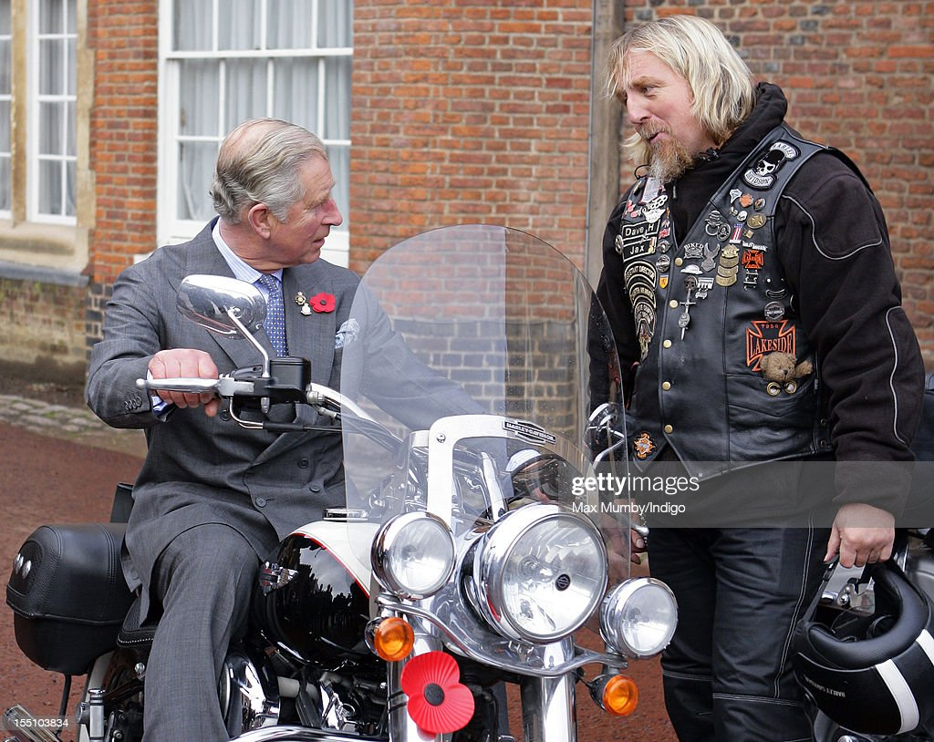 Prince Charles, Prince of Wales sits on a Harley-Davidson motorbike belonging to a member of The Royal British Legion Riders Branch as he meets London Poppy Day ambassadors and collectors at St. James's Palace on November 01, 2012 in London, England.