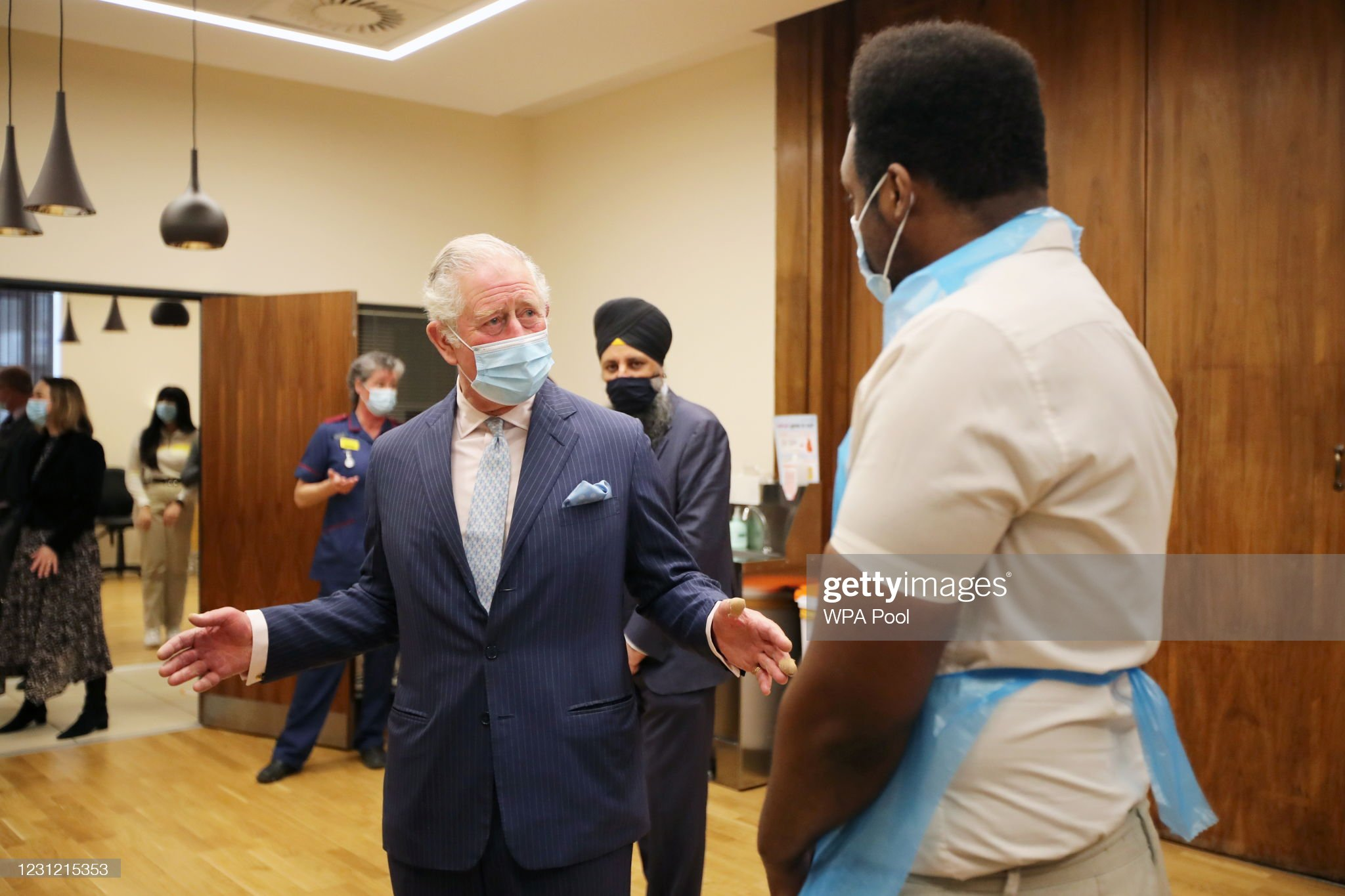 prince-charles-prince-of-wales-speaks-to-a-member-of-staff-during-a-picture-id1231215353