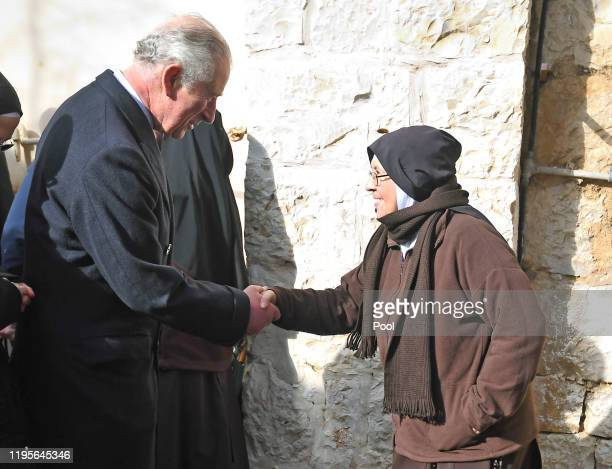 Prince Charles Prince of Wales speaks to a nun during a visit to a traditional olive grove and fruit orchard in an historic convent on January 24...