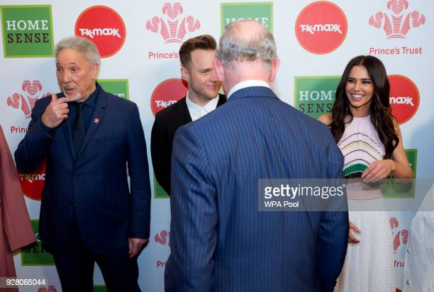 Prince Charles Prince of Wales speaks to Celebrity Trust Ambassador Cheryl and Olly Murs as Tom Jones looks on at The Prince's Trust Awards at The...