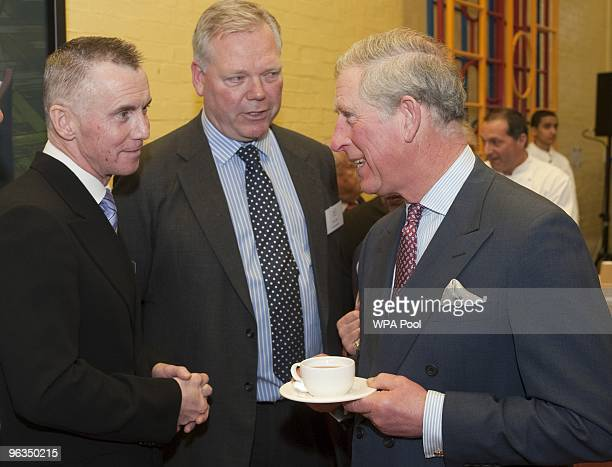Prince Charles Prince of Wales speaks to chef Gary Rhodes attends the launch of 'Chefs Adopt A School' programme at St George's primary school in...