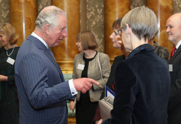 Prince Charles Prince of Wales speaks to guests during The Queen's Anniversary Prizes at Buckingham Palace on February 20 2020 in London England...