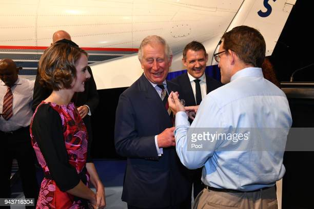 Prince Charles Prince of Wales speaks to member of the community during a reception at the Royal Flying Doctors Service Tourist Facility in Darwin on...