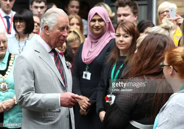 Prince Charles, Prince of Wales speaks to wellwishers after a visits to a Prince's Trust call centre, where he met staff who help over 72,000 young...
