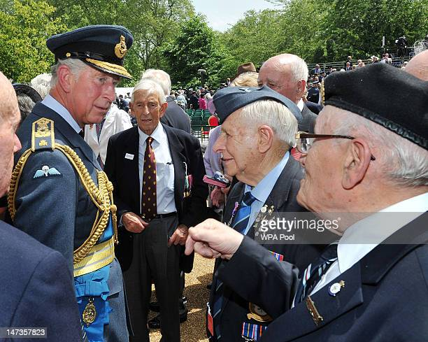 Prince Charles Prince of Wales speaks to WWII veteran Les Temple from Ilford Essex after Queen Elizabeth II unveiled the Bomber Command Memorial at...