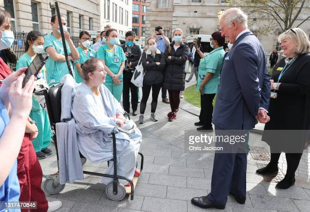 Prince Charles, Prince of Wales speaks with a patient and nursing staff during a visit to St Bartholomew's Hospital, ahead of International Nurses...