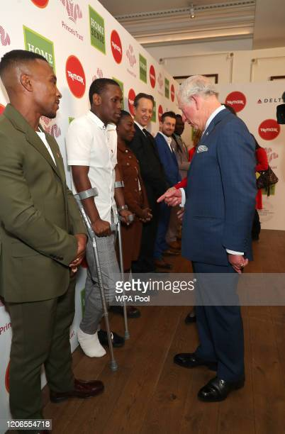 Prince Charles Prince of Wales speaks with actors Michael Ward and Ashley Walters as he arrives at the annual Prince's Trust And TK Maxx Homesense...
