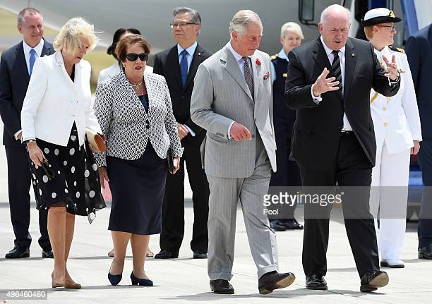 Prince Charles Prince of Wales speaks with Australia's GovernorGeneral Sir Peter Cosgrove as he and Camilla Duchess of Cornwall arrive for their...