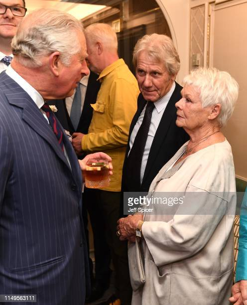 Prince Charles Prince of Wales speaks with Dame Judi Dench as he attends the Fortnum Mason Food Drink awards held at Fortnum Mason on May 16 2019 in...