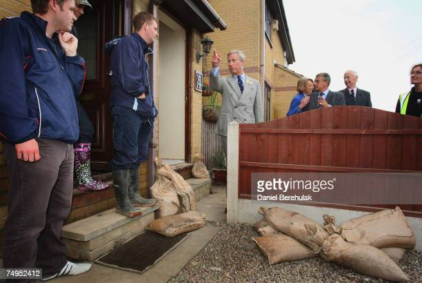 Prince Charles Prince of Wales speaks with local resident Russell Baxter during a visit to flood effected areas on June 29 2007 in Catcliffe near...