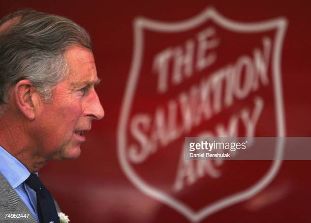Prince Charles Prince of Wales speaks with local residents during a visit to flood effected areas on June 29 2007 in Catcliffe near Sheffield England...