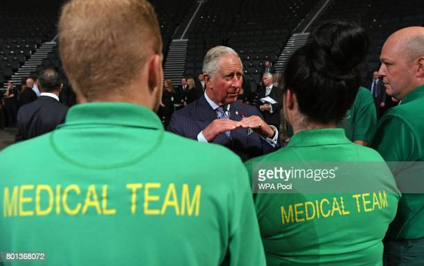 Prince Charles Prince of Wales speaks with medical and security staff who helped the victims of the Manchester terror attack at Manchester Arena on...