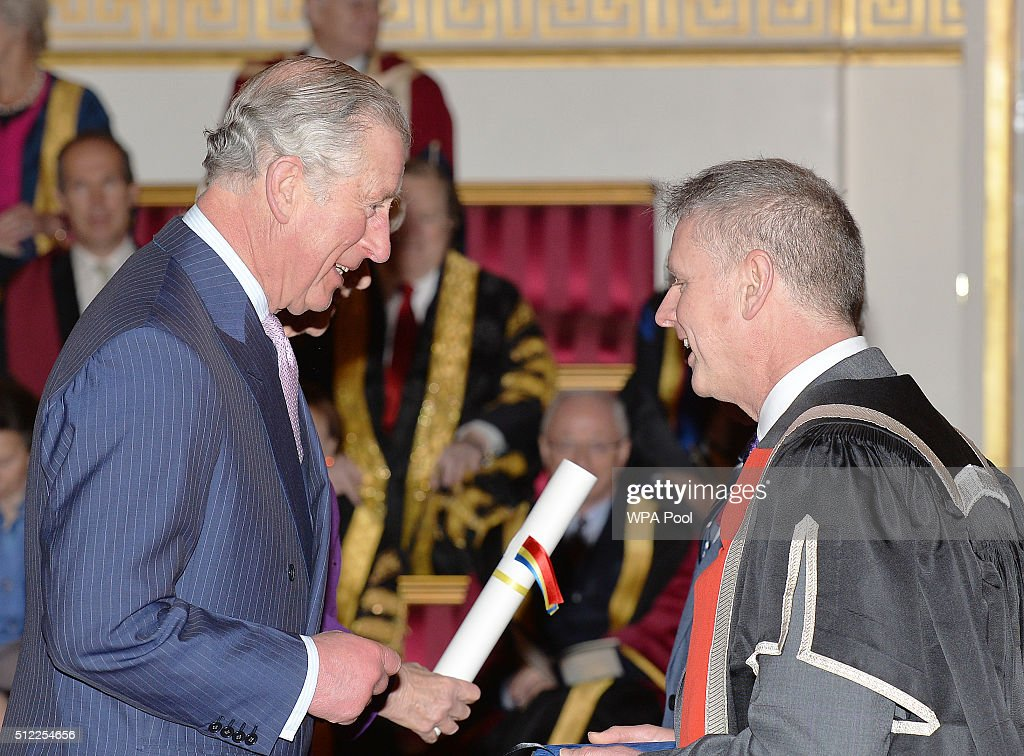 Prince Charles, Prince of Wales speaks with Professor Colin Riordan of Cardiff University, during the presentation of The Queen's Anniversary Prizes for higher and further education, at a ceremony in Buckingham Palace on February 25, 2016 in London, England.