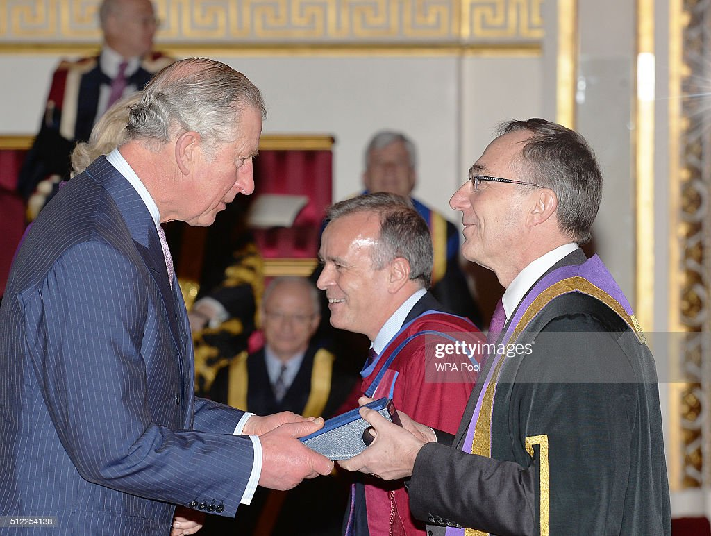 Prince Charles, Prince of Wales speaks with Professor Michael Arthur of University College London Institute of Education, during the presentation of The Queen's Anniversary Prizes for higher and further education, at a ceremony in Buckingham Palace on February 25, 2016 in London, England.