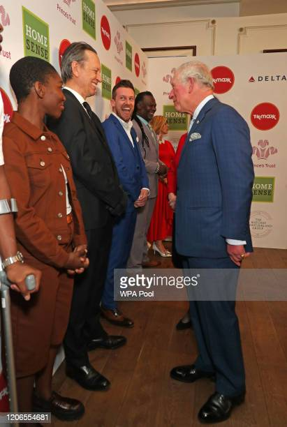Prince Charles Prince of Wales speaks with Richard E Grant as he attends the Prince's Trust And TK Maxx Homesense Awards at London Palladium on March...