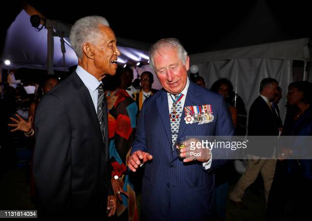 Prince Charles, Prince of Wales speaks with West Indies' cricket legend Garfield Sobers during a reception at the Prime Minister's residence during...