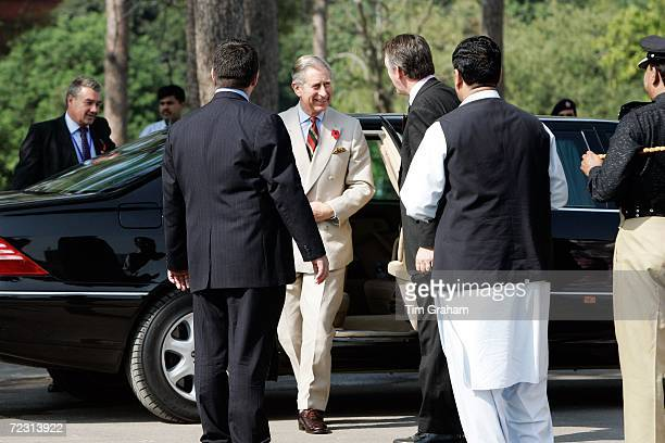 Prince Charles, Prince of Wales, surrounded by security, arrives at the all female Fatima Jinnah University on October 31, 2006 in Rawalpindi,...