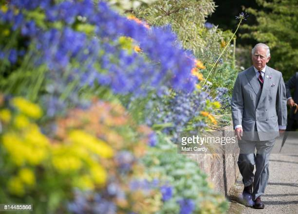 Prince Charles Prince of Wales takes a tour of the gardens at Plas Cadnant Hidden Gardens during The Prince of Wales' annual summer visit to Wales on...