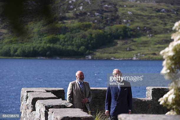 Prince Charles Prince of Wales takes in the surroundings from the boathouse roof with their guide Mr Dave Duggan Divisional Manager Parks and...