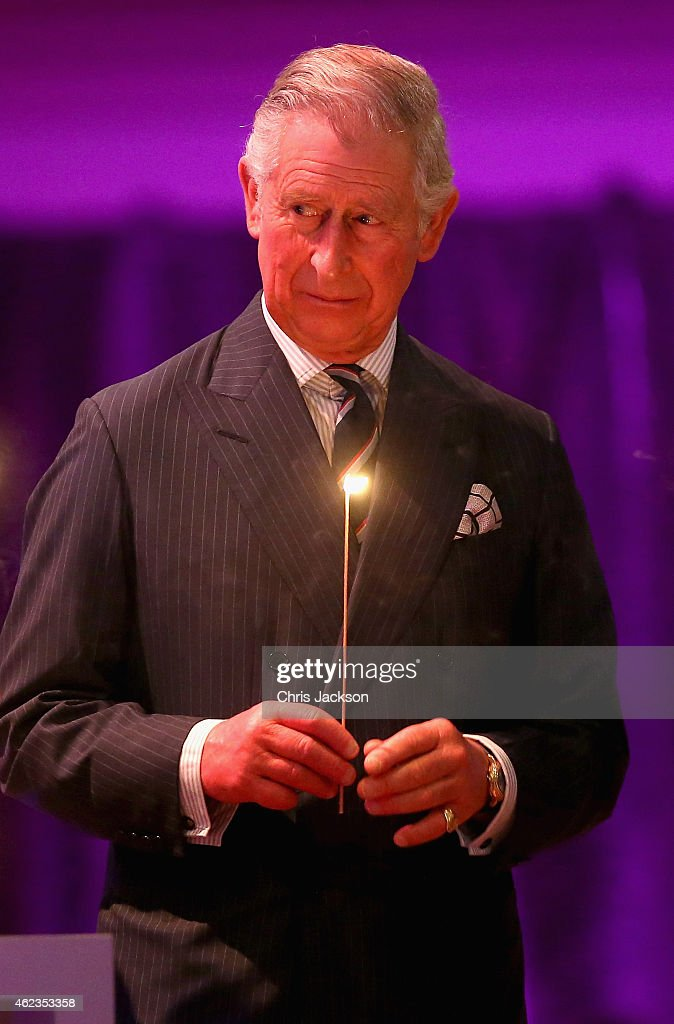 Prince Charles, Prince of Wales takes part in a candle lighting ceremony on stage as they attend a Holocaust Memorial Day Ceremony at Central Hall Westminster on January 27, 2015 in London, England.