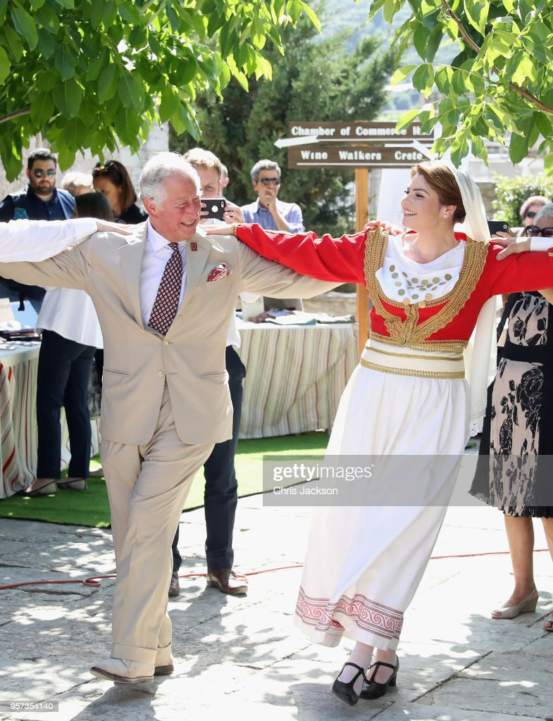 Prince Charles, Prince of Wales takes part in a traditional dance at Church Square on May 11, 2018 in Crete, Greece.