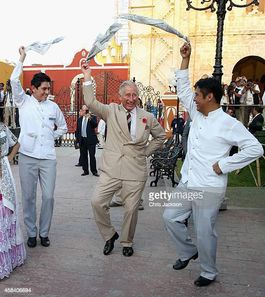Prince Charles, Prince of Wales takes part in traditional Mexican clog dancing in Zocalo Square on November 4, 2014 in Campeche, Mexico. The Royal...