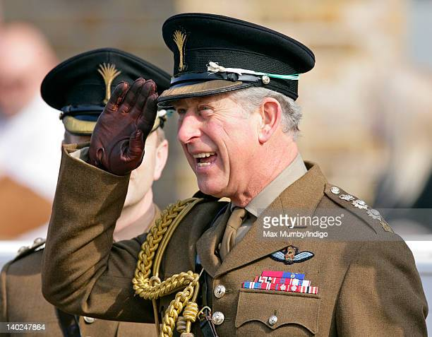 Prince Charles Prince of Wales takes the salute after presenting leeks to mark St David's Day to the 1st Battalion The Welsh Guards at Cavalry...