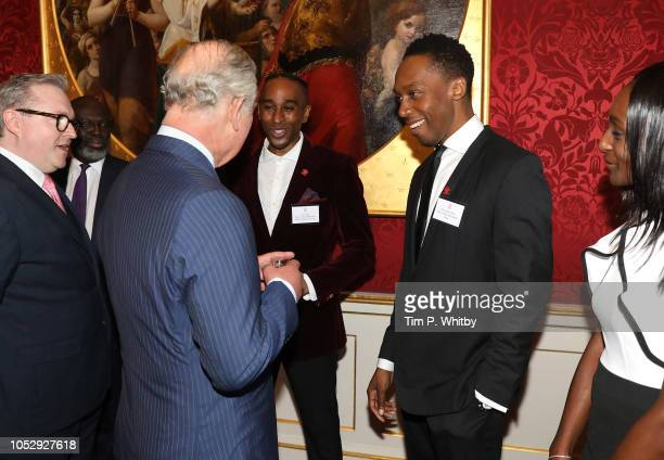 Prince Charles Prince of Wales talking with singer and songwriter Lemar at a reception to mark their upcoming tour to Gambia Ghana and Nigeria at St...