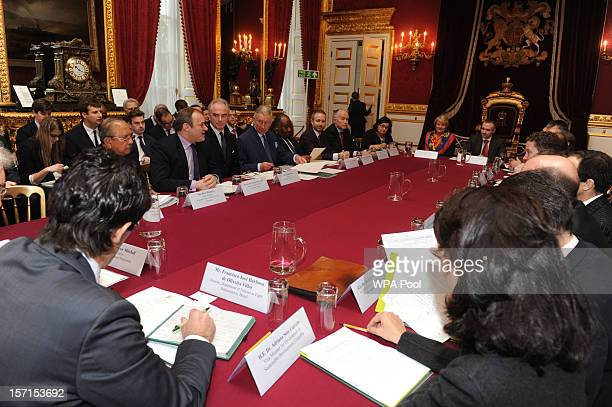Prince Charles Prince of Wales talks during a meeting of international leaders to discuss curbing world deforestation in the Thorne Room at Clarence...