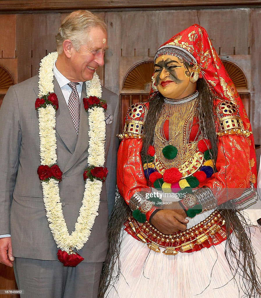 Prince Charles, Prince of Wales talks to a dancer in traditional attire after a performace at the cultural museum on day 6 of an official visit to India on November 11, 2013 in Kochi, India. This will be the Royal couple's third official visit to India together and their most extensive yet, which will see them spending nine days in India and afterwards visiting Sri Lanka in order to attend the 2013 Commonwealth Heads of Government Meeting.