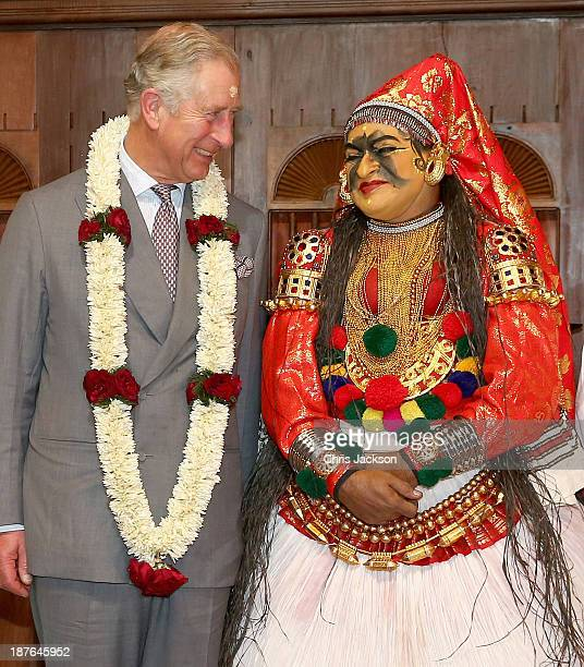 Prince Charles Prince of Wales talks to a dancer in traditional attire after a performace at the cultural museum on day 6 of an official visit to...