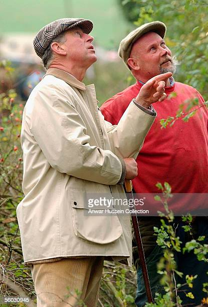 Prince Charles Prince of Wales talks to a participant during the National Hedge Laying Championships at Home Farm on October 29 2005 in Tetbury...