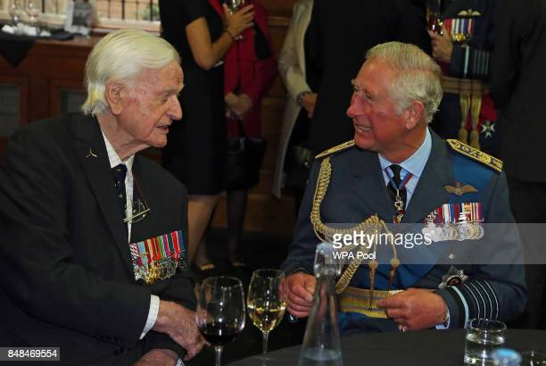 Prince Charles Prince of Wales talks to Battle of Britain veteran Wing Commander Tom Neil during a reception following a service marking the 77th...