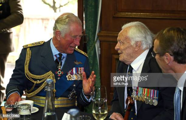Prince Charles Prince of Wales talks to Battle of Britain veteran Squadron Leader Geoffrey Wellum during a reception following a service marking the...