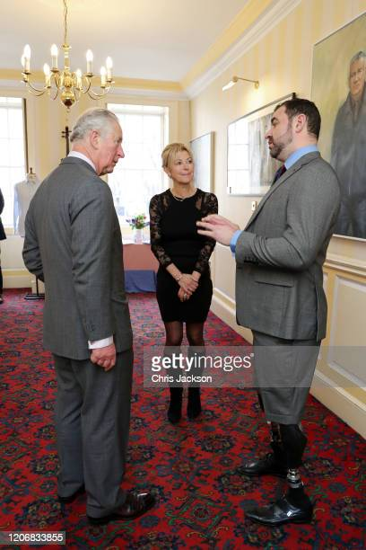 Prince Charles Prince of Wales talks to Emma Willis and Andy Reid veteran and fundraiser for 'Style for Soldier' during his visit at the Emma Willis...