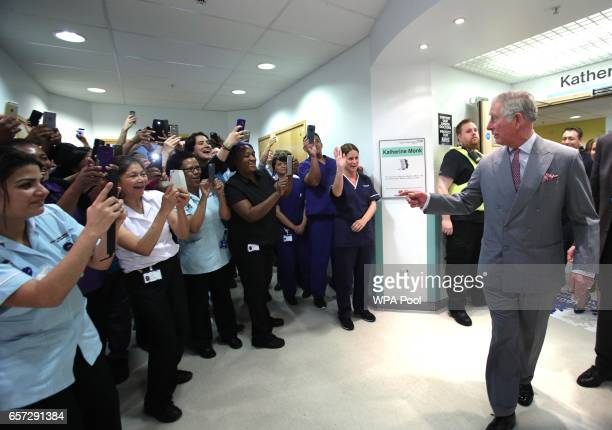 Prince Charles Prince of Wales talks to nurses as he meets paramedics nurses and support staff who assisted those injured in the terrorist incident...