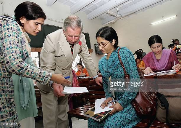 Prince Charles Prince of Wales talks to pupils in a public administration lesson at Fatima Jinnah Women's University on the third day of the Royal...