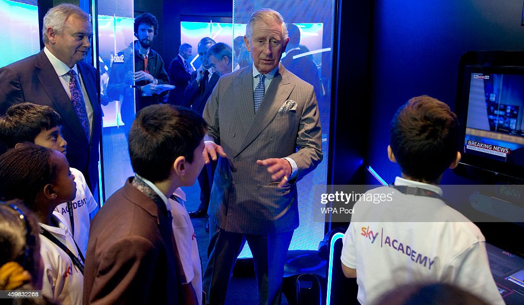 Prince Charles, Prince of Wales talks to school children who were learning how to put together a news item in mock studios during a visit to Sky on December 2, 2014 in London, England.