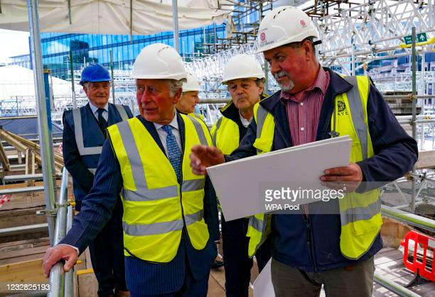 Prince Charles, Prince of Wales talks to site manager Mick Sterne as he views construction and preservation work being undertaken in preparation for...