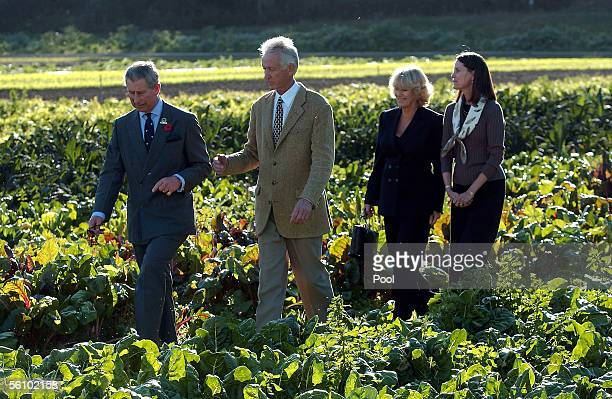 Prince Charles Prince of Wales talks to Warren Weber followed by Camilla Duchess of Cornwall and an unidentified lady during a visit to Webber's...