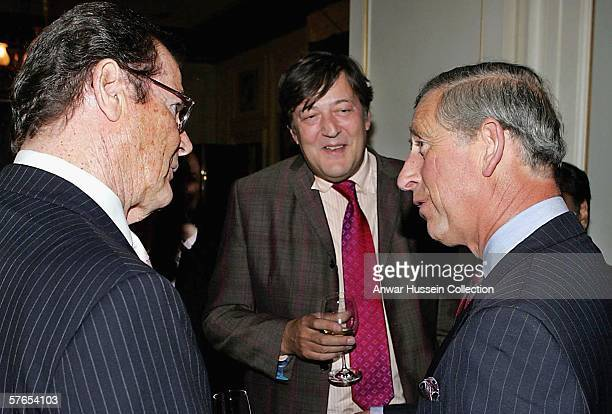Prince Charles Prince of Wales talks with actors Roger Moore and Stephen Fry during a reception at Clarence House prior to The Prince's Trust 30th...